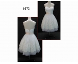 1673 short length bridal gown with lace and petal decorate